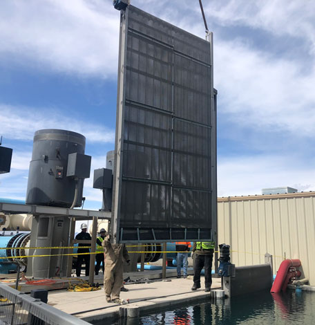 Traveling Water Screen system replacing traditional water screens at a geothermal power plant.